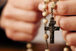 bigstock-Woman-praying-with-rosary-WEB